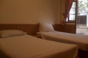 В комнате New Joe Guesthouse в Бангкоке