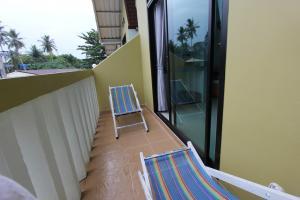 На балконе в Harmony Bed And Bakery