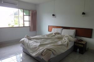 Кровать в Pure Mansion Hotel